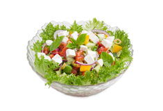 Greek salad in glass salad bowl on a light background Stock Photo