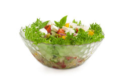 Greek salad in glass salad bowl on a light background Royalty Free Stock Photography