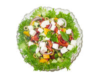 Greek salad in glass salad bowl on a light background Royalty Free Stock Images