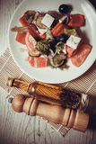 Greek salad with goat cheese and olive oil Royalty Free Stock Photos