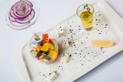Greek Salad with graceful submission. On plate stock images