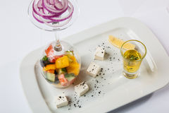 Greek Salad with graceful submission. On plate stock photos