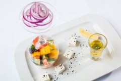 Greek Salad with graceful submission. On plate stock image