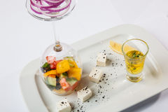 Greek Salad with graceful submission. On plate stock photography