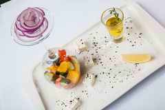 Greek Salad with graceful submission Royalty Free Stock Photos