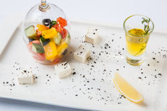 Greek Salad with graceful submission. On plate stock photo