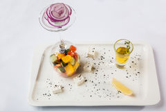 Greek Salad with graceful submission. On plate royalty free stock photos