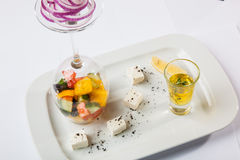 Greek Salad with graceful submission. On plate royalty free stock images