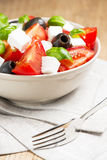 Greek salad in grey bowl Royalty Free Stock Photography