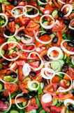 Greek salad. Healthy salad with tomatoes, cucumbers, onions and olives Stock Image