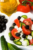 Greek salad and ingredients Royalty Free Stock Image