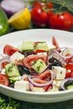 Greek Salad with Ingredients Behind Stock Image