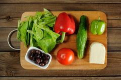 Greek salad ingredients. On wood board and wooden background Stock Photography