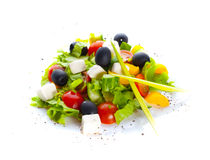 Greek salad. Isolation on the white Royalty Free Stock Image