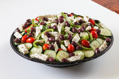 Greek salad. Large greek salad in bowl with olives and tomatoes Royalty Free Stock Images