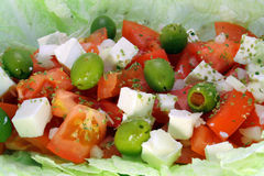 Greek salad macro. Greek salad wit tomato, cheese and olives Royalty Free Stock Photos