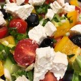 Cool greek salad macro. Greek salad macro, food, cuisine, healthy, vegetable, black, cheese, closeup, fresh, green, leaf, oil, olive, onion, pepper, red royalty free stock image