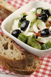 Greek salad. Olives, cucumber, tomato, onions and parsley with bread Royalty Free Stock Images