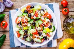 Greek salad of organic tomatoes, cucumber, red onion, olives and feta cheese Royalty Free Stock Image