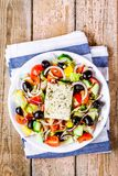 Greek salad of organic tomatoes, cucumber, red onion, olives and feta cheese Royalty Free Stock Photos