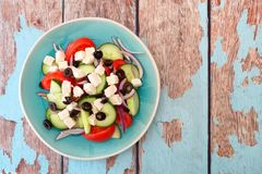Greek Salad overhead view with rustic wood background Stock Photography