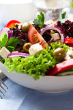 Greek salad with pepper stuffed olives Royalty Free Stock Image