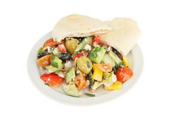 Greek salad and pitta bread Stock Images