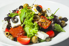 Greek salad in a plate Stock Photos