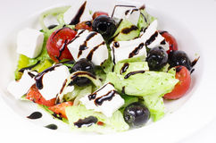 Greek salad. In plate close-up Stock Image