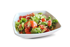 Greek salat. A plate of delicious greek salat isolated on a white background Stock Photography