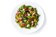 Greek salad in a plate on an isolated white background stock photography