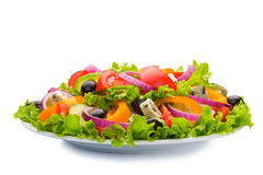 Greek salad in plate isolated Royalty Free Stock Images