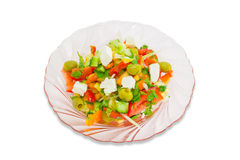 Greek salad on a plate of pink glass Royalty Free Stock Image