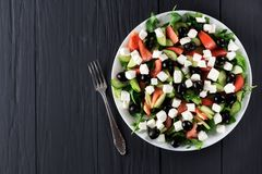 Greek salad on a plate. Top view stock photography