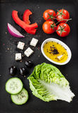 Greek salad recipe ingredients on black chalkboard from above royalty free stock photography