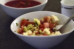 Greek salad with red beets soup background royalty free stock photos