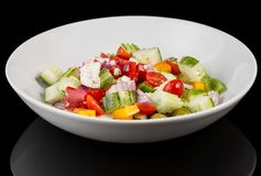 GREEK SALAD with reflection  on black background royalty free stock photos