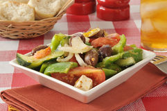 Greek salad with rolls Stock Photography