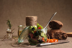 Greek salad served in glass jar with ingredients Royalty Free Stock Photography