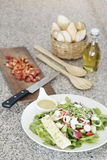 Greek salad set with bread and olive oil Stock Image