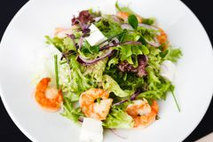 Greek salad with shrimp. Greek salad with feta cheese and smoked shrimp Stock Photo