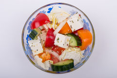 Greek salad. In a small cup on white background top view Stock Photos