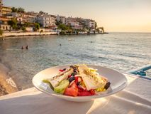 Greek Salad in sunset light at a tavern in Skala Marion town, Thasos Island, Greece stock images