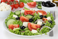 Greek salad on table in bowl with tomatoes, Feta cheese and oliv Stock Photos