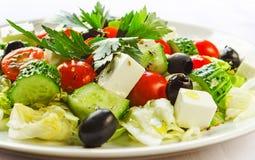 Greek salad. Tasty Greek salad on a white table Stock Photography