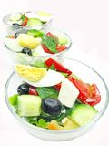 Greek salad in three portion bowls Stock Photos