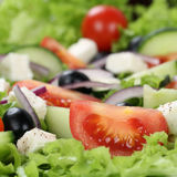 Greek salad with tomatoes, cheese and olives close up Royalty Free Stock Images