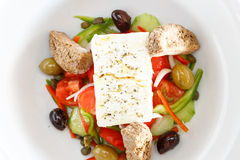 Greek Salad. With with tomatoes, cucumber, peppers feta cheese and oregano stock images