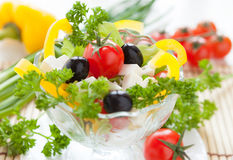 Greek salad in a transparent bowl Royalty Free Stock Photos