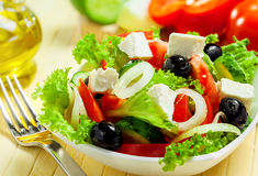 Greek salad. Greek vegetable salad with feta cheese Stock Photos